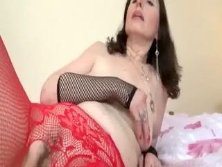 older bitch in hose masturbates in ottoman
