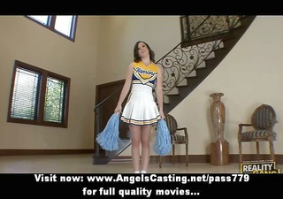 Brunette cheerleader flashing panties and doing