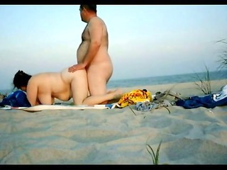 intimate doggy style sex on the beach