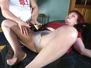 Lewd mom with nylon tights stuffed under pantyhose
