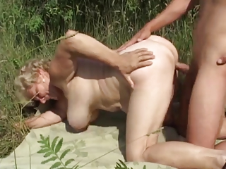 german granny outdoor with juvenile lad by troc