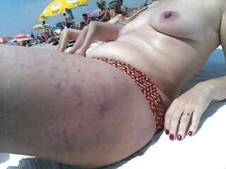 Wife topless in the beach
