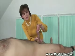 aged breasty hottie plays with schlong