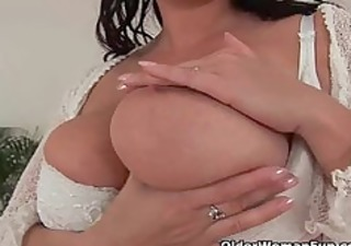 older mama with large tits works her pussy with
